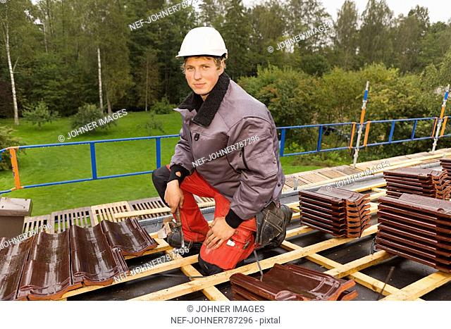 A young man roofing, Sweden