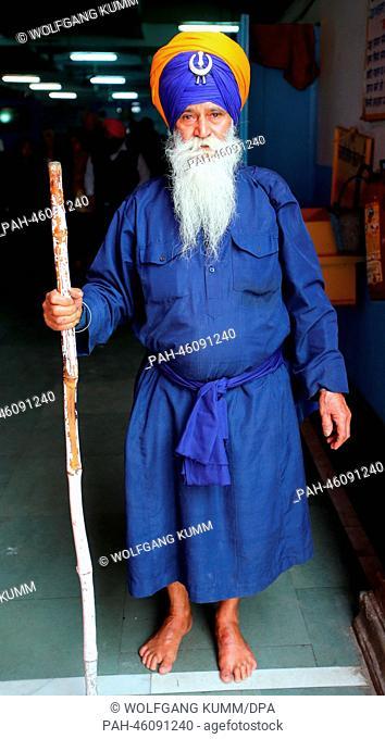 An elderly man leaves the kitchen at the Gurudwara Sis Ganj Sahib Sikh tempel during a tour of New Dehli, India, 05February 2014