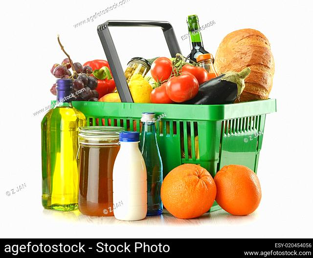 shopping basket with grocery products isolated on white