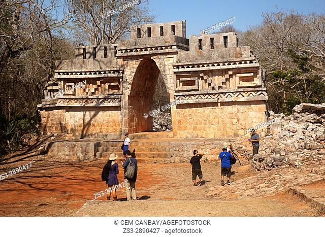 Tourists in front of the Labna Arch in the Labna Archaeological site, Puuc Route, Merida, Yucatan State, Mexico, Central America