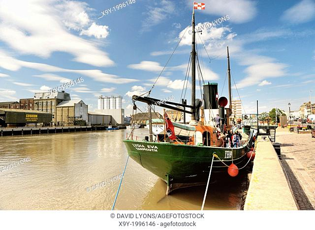 River Yare at South Quay, Great Yarmouth, England. Vintage steam drifter herring boat Lydia Eva built 1930. Waveney mills behind