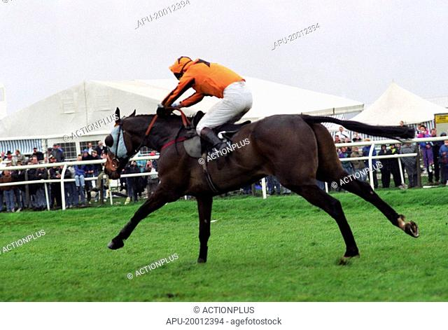 Horse and Jockey land over steeplechase jump and gallop forward