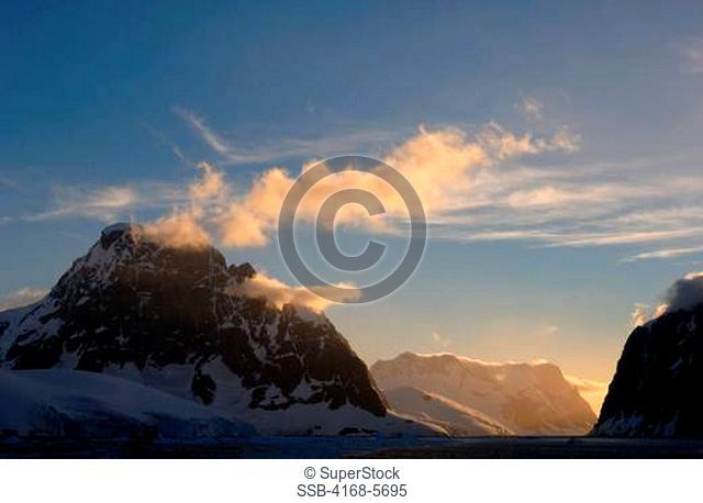 ANTARCTICA, ANTARCTIC PENINSULA, VIEW OF LEMAIRE CHANNEL, MOUNTAINS AND GLACIERS IN EVENING LIGHT