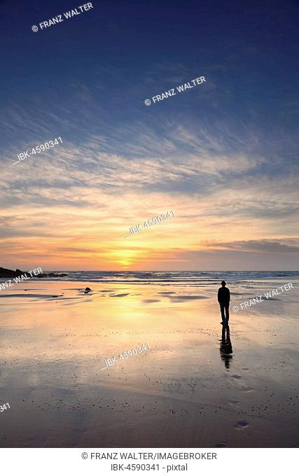 Woman at Praia da Borderia beach at sunset, Carrapateira, Costa Vicentina, West coast, Algarve, Portugal
