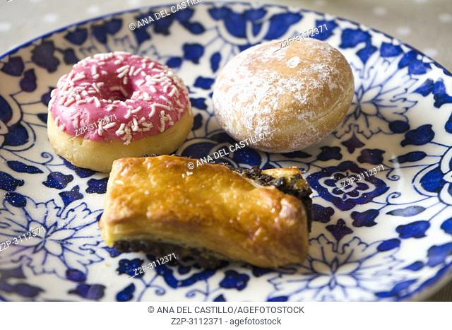 Three pastries on blue plate Breakfast