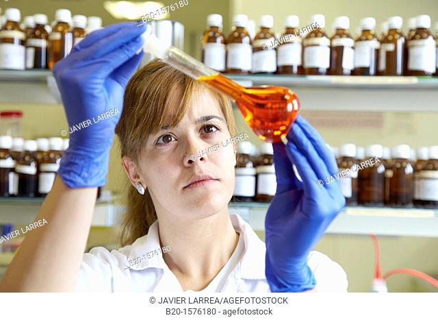 Technicians get a solutions in flask, Laboratory quality control, Pharmaceutical plant, Research Center, Pharmacy, Area Health, Tecnalia Research & Innovation