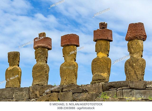 Moai with scoria red topknots at the restored ceremonial site of Ahu Nau Nau at Anakena on Easter Island, Isla de Pascua, Rapa Nui, Chile