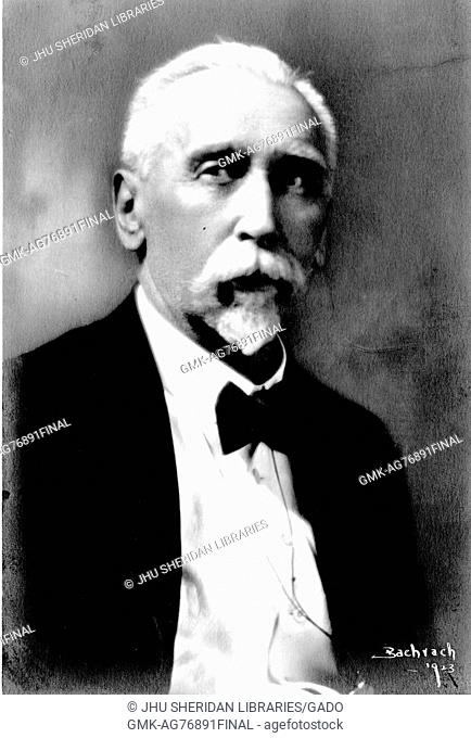 A shoulders up portrait of German historical linguist Hermann Collitz in a suit at 70 years of age, 1923
