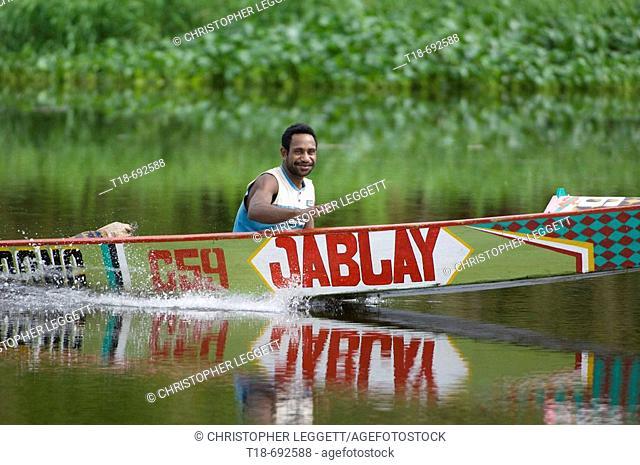 Man in motor boat, Indonesia