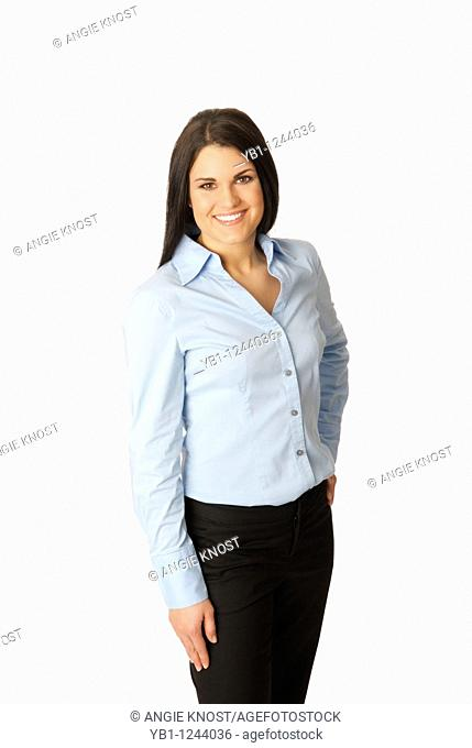 Attractive, smiling woman wearing blue button-down shirt and black slacks