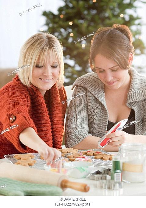 Women decorating Christmas cookies