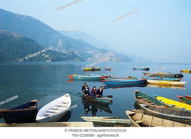 Schoolgirls going to school by boat. Lake Phewa, Nepal