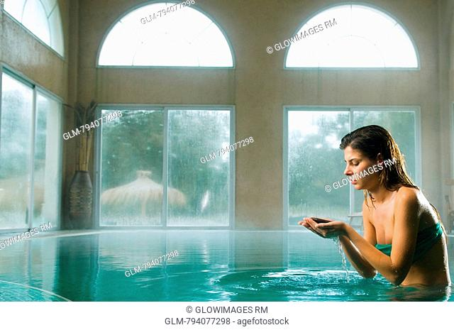 Young woman bathing in a swimming pool