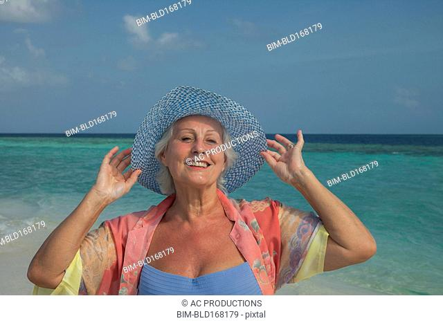 Older Caucasian woman smiling on beach