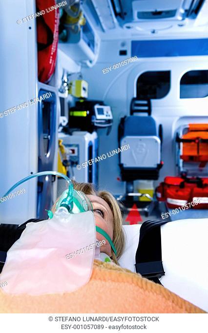 Injured Woman With Oxygen Mask, ambulance interior
