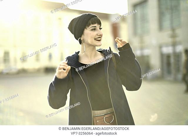 one positive woman moving arms, in city Cottbus, Brandenburg, Germany