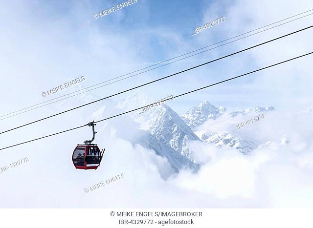 Gondola in the fog in front of mountain panorama, Motta Naluns, Scuol, Canton of Grisons, Switzerland