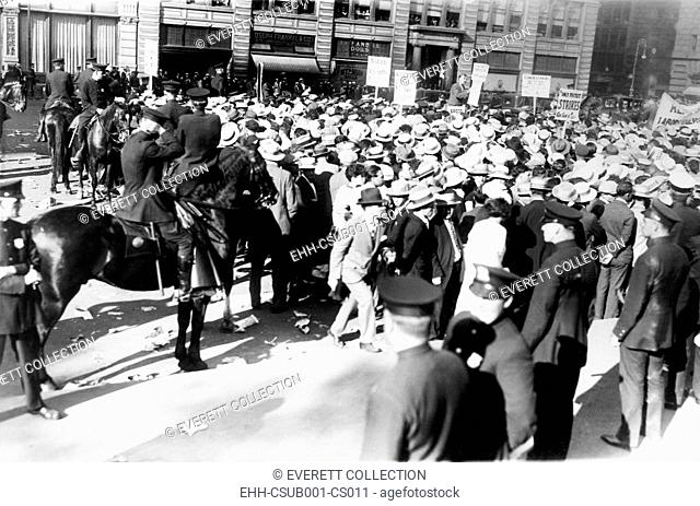Mounted police forcing their horses to disperse the great horde of socialists at Union Square. They were attending a mass meeting held to protest the death...
