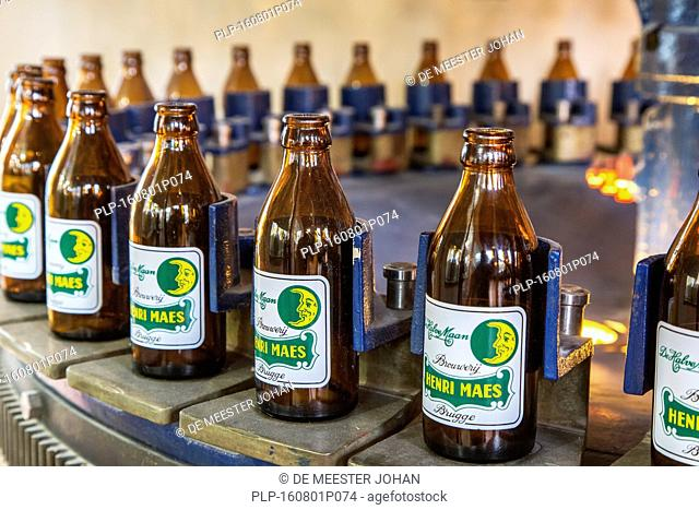 Beer bottles on the assembly line of Brouwerij Henri Maes, Belgian brewery at Bruges, Belgium