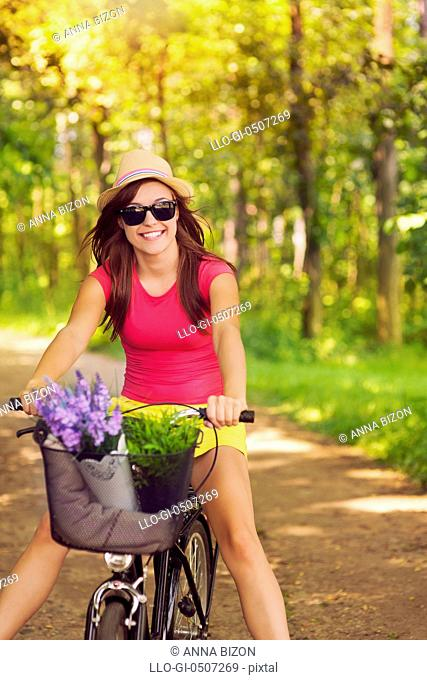 Beautiful woman have fun during cycling, Debica, Poland