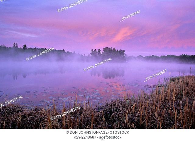 Morning skies over misty lake, Greater Sudbury, Ontario, Canada