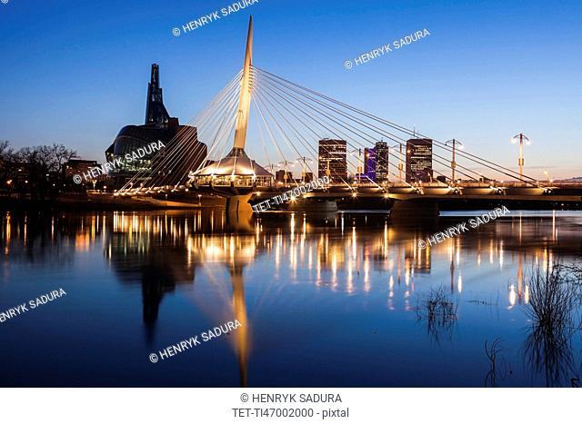 Canada, Manitoba, Winnipeg, Red river reflecting Esplanade Riel Bridge