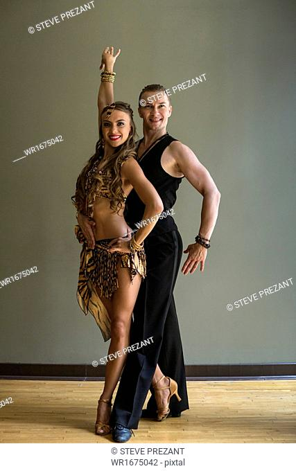 A man and woman dancing together in a dance studio