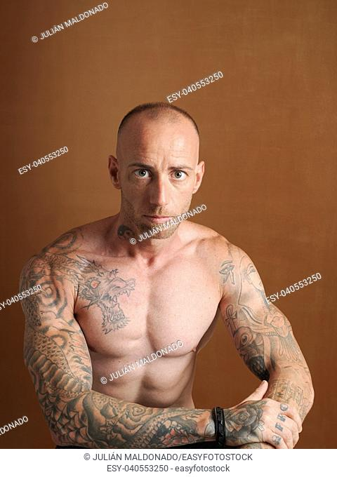 Young bodybuilder showing his physiognomy