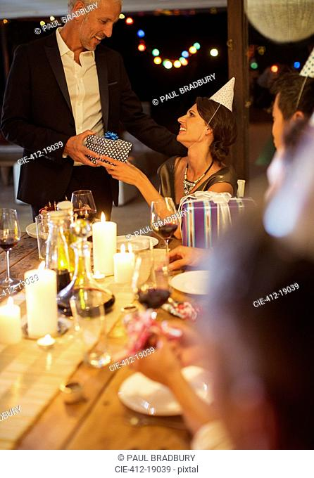 Man giving present at birthday party