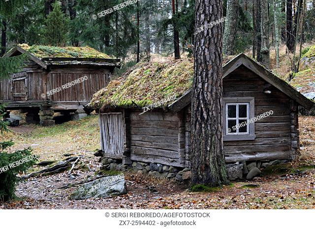 Seurasaari park featuring ancient houses on an islet, Helsinki, Finland. The Museum Island of Seurasaari, houses and other wooden architecture brought from all...