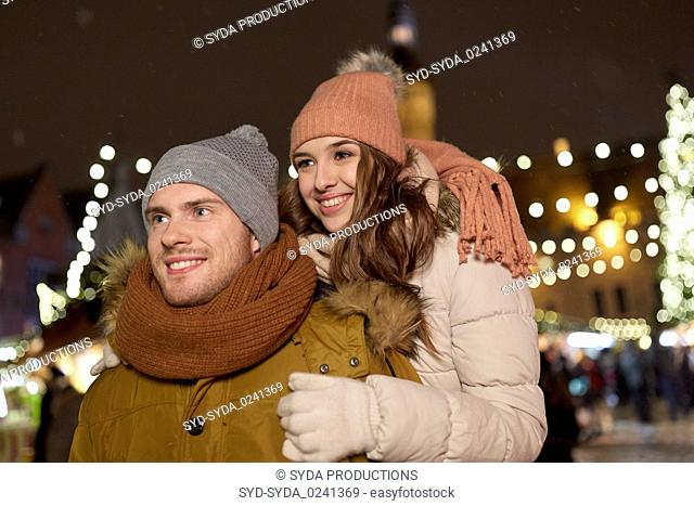 happy couple hugging at christmas market