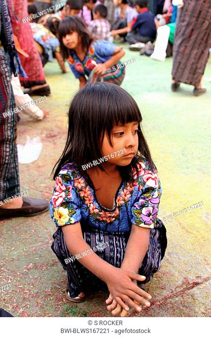 Mayan child with confetti in the middle of a Maya procession in Santiago de Atitlan, Guatemala, Atitlansee, Santiago de Atitlan