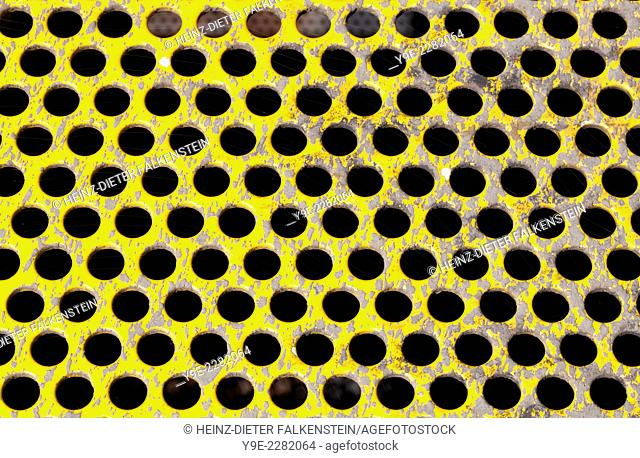 old perforated metal plate