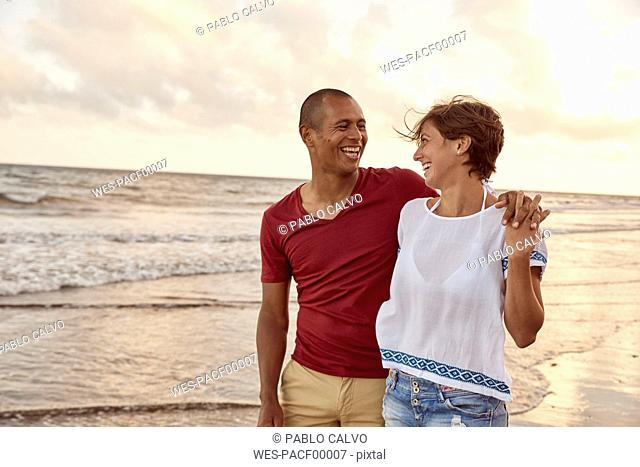 Couple in love face to face on the beach