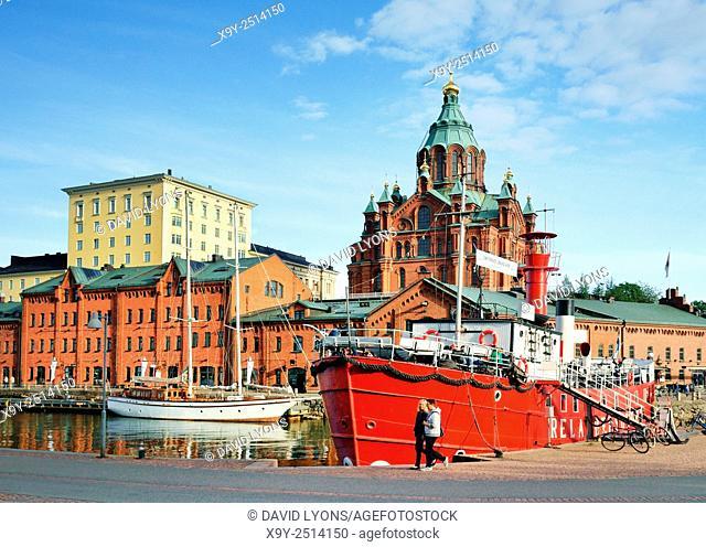 Helsinki, Finland. The Russian Orthodox Uspenski Cathedral rises behind retired light vessel Relandersgrund, now a restaurant