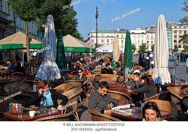 Colorful small cafe outdoor in Main Market Square beautiful Krakow Poland