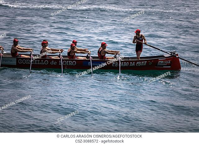 CASTRO URDIALES, SPAIN - JULY 15, 2018: Competition of boats, regata of trainera, Cabo boat in action in the VI Bandera CaixaBank competition