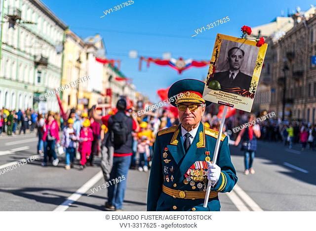 Immortal regiment - Veteran people carry banners with a photograph of their warrior ancestors, Victory Day, Nevsky Prospect, St. Petersburg, Russia