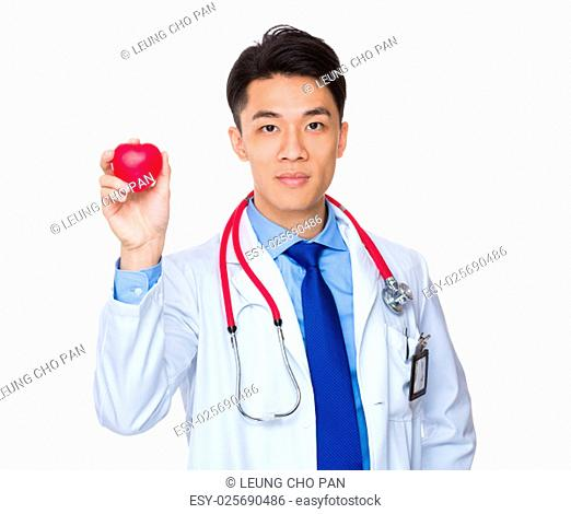 Doctor hold up with red heart ball