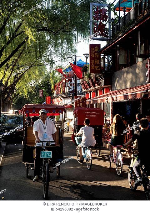 Street scene, bicycles and rickshaw, See Hou Hai, Beijing, China