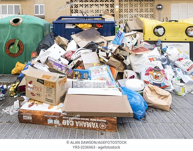 Cardboard and boxes piled in front of recycling containers for household waste at Christmas in street in Las Palmas, Gran Canaria, Canary Islands, Spain