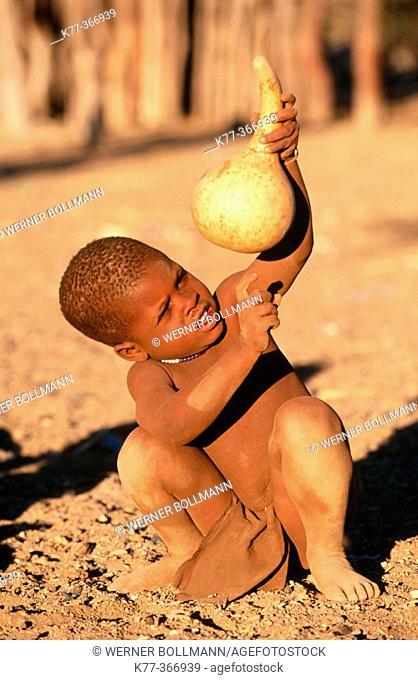 Himba child with pumpkin. Kaokoveld. Namibia