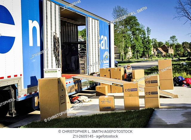 Boxes ready to load into a residential mover truck outside a home in Fort Gratiot MI
