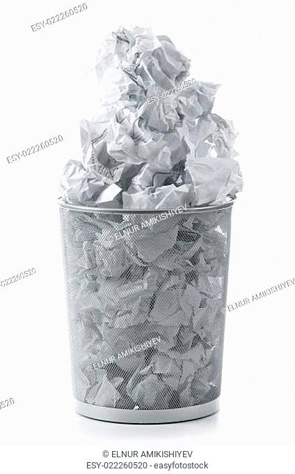 Garbage bin with paper waste isolated on white