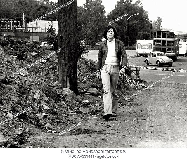 Claudio Baglioni in the outskirts of Rome. The Italian singer Claudio Baglioni walks in the outskirts of the city. Rome, 1974