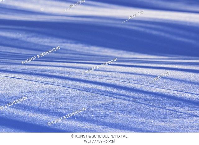 Patterns in the snow that is covering a frozen lake