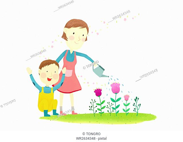 Smiling mother and son watering flowers
