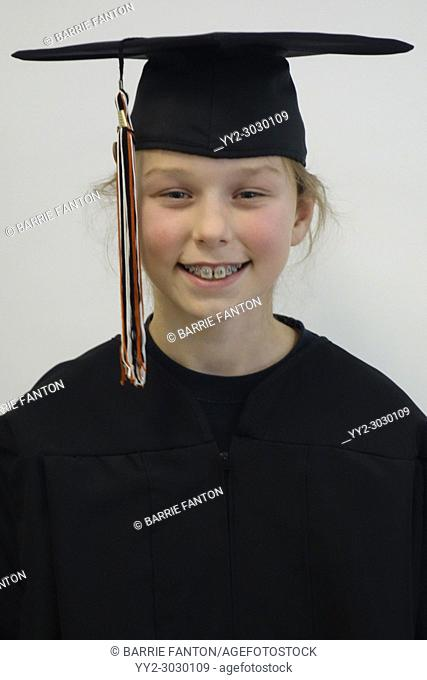 6th Grade Girl in Cap and Gown, Wellsville, New York, USA