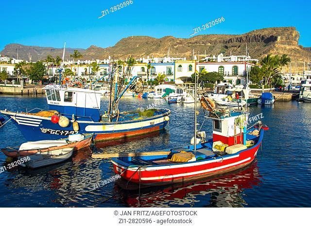 colorfull little fishing boats in harbour of puerto de mogan, gran canaria, spain