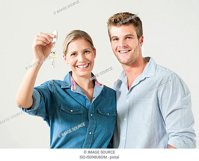 Young couple holding house keys